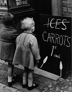 cruello:    Two little girls read a board advertising carrots instead of ice lollies. Wartime shortages of chocolate and ice cream made such substitutions a necessity, April 1941.  Photo:Fox Photos/Getty Images  via