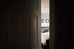 Creative-Framing-through-Doorway-Peeking-in-on-Son-and-Dad-by-Nicole-Sanchez