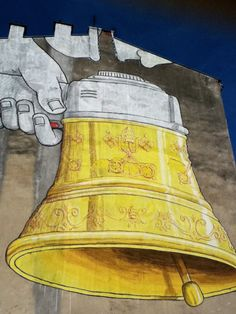 ^Blu in Krakow - unurth | street art  Bullhorn or bell... both for sounding the alarm!