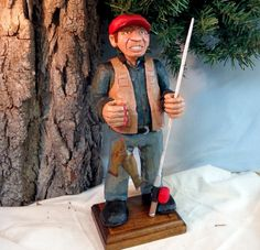 Hand carved wood fisherman in tan vest with by WeAreOutofOurGourds, $95.00