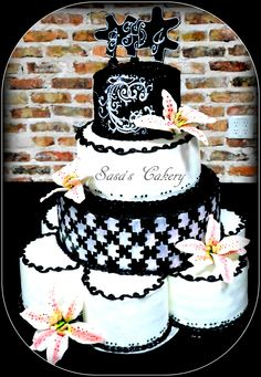 4 tier Lady Windermere/puzzle theme wedding cake , All Buttercream, with sugar paste Star Gazer lily's
