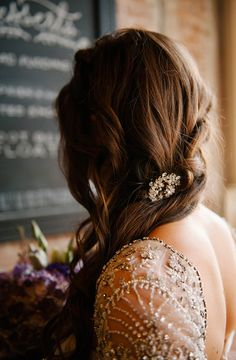 wedding or special occasion hair, wavy and to the side with a hint of sparkle.