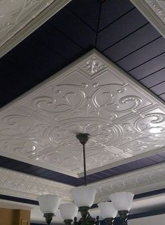 This is a ceiling feature made from pressed metal panels and VJ boards.  The panels name is Victoria and the cornice is called Strand.  For extra photos see:  http://www.heritageceilings.com.au/clients-projects/woodward-feature-ceiling.php
