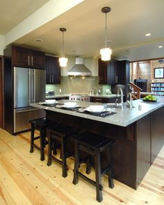 Find the light floors & dark cabinets actually work & liven up the space.