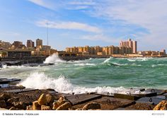 "The Typical Cityscape of Alexandria, Egypt - Alexandria is Egypt's port city on the Mediterranean Sea also known as ""The Pearl of the Mediterranean"". It combines best of both, old and new, from ruins and monuments to wonderful beaches and modern art making it a great destination for every traveler."