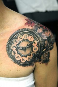 Very nice clock tattoo. I like the wrap around on the shoulder, and really want to see the back of it.