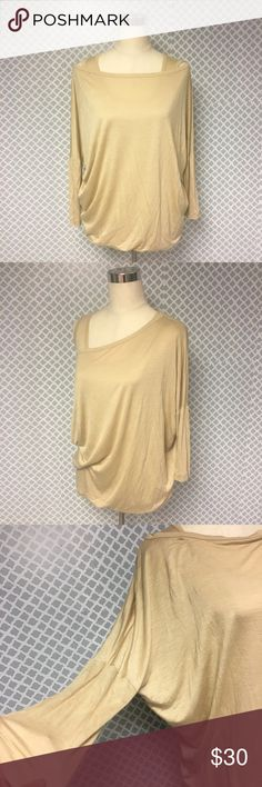 St. John Golden Off the Shoulder Oversized Blouse St. JOHN Yellow Label Golden Off the Shoulder Oversized Blouse. Women's size small. Excellent condition, but it may have some dirty spots however they will come out. I just wasn't able to get it dry cleaned. Such a beautiful Blouse in need of a new home! 90% Rayon 10% Silk so you know you'll never wanna take it off 😍 St. John Tops Blouses