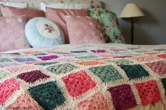 Granny blanket in beautiful faded colours, made by Living life creatively