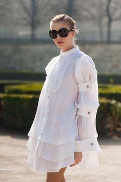 Elena Perminova, Paris Fashion Week March 2011, wearing a floaty white shirt dress