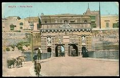 An old hand painted postcard showing a herdsman with his goats going to Valletta to sell his milk near Colonel Thompson's Porta Reale at the entrance of Valletta, Malta. Picture Postcards, Old Postcards, Malta Valletta, Salisbury Cathedral, Sunken Garden, Old Hands, Maltese, See Picture, Hand Coloring