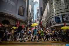 CHINA, HONG KONG : Protesters hold yellow umbrellas, a symbol of Hong  Kong's pro-democracy movement, as they attend a rally in Hong Kong on  May 31, 2015, to commemorate the 1989 crackdown at Tiananmen Square in  Beijing, prior to the incident's 26th anniversary on June 4. Thousands  are expected on June 4 for the annual remembrance ceremony to mark the  26th anniversary of the Tiananmen Square crackdown.   AFP PHOTO /  ANTHONY WALLACE