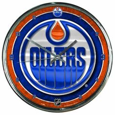 """NHL Edmonton Oilers Chrome Clock by WinCraft. $12.55. Officially licensed wall clock. Attention grabbing styling for any room. Shiny Chrome plastic construction with glass lens and metal hands. High quality quartz movement with a sweep second hand. Requires one (AA) battery. Measures 12"""" in diameter. Decorated and Assembled in USA with a China Components"""