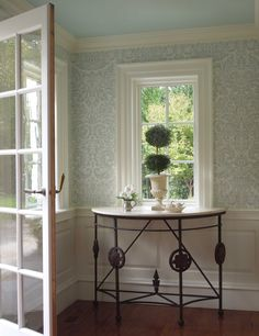 Farrow and Ball Wallpaper.. Need to look them up. Want one wall of paper in the 1/2 bath to add character to small space.