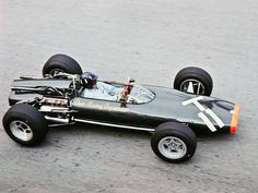 Graham Hill 1966 BRM P83 with the infamous H-16 motor. 16 cylinders.