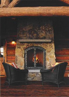Black with rustic looks so good! Love the iron doors on the fireplace.