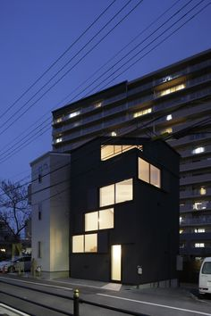Windows spiral towards the roof of this Osaka house by Alphaville Architects.