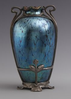 """Fine Loetz Blue Iridescent Oil Spot Vase w/Stylized Floral Pewter Mounts, Van Hauten Pewter Mounts. Pictured on the cover of """"Christie's Art Nouveau"""" by Fiona Gallagher."""