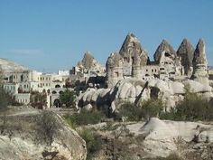 In central Turkey, the wondrous district of Cappadocia (often misspelled as Cappedocia or Capedocia) is located. Here, men and nature created a landscape of mountains, caves, and strange rock formations.