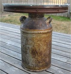 Rusty Wagon Wheel & Milk Can Table - pretty sure I know where to find both :)