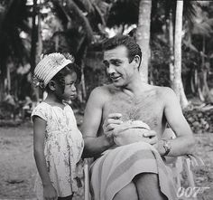 Happy Birthday to Sean Connery. Connery played James Bond in six official Bond films from 1962 to 1971. Here he is talking to a local child on the set of DR. NO. #BTS