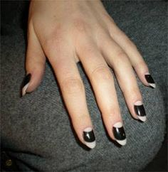 Pointed black and white manicure with half-moons
