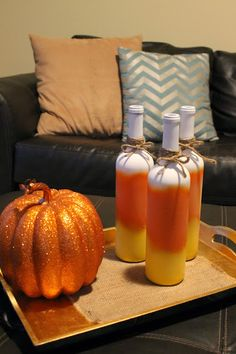Candy Corn Painted Wine Bottles #diy #halloween #spraypaint #falldecor