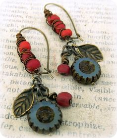 Beautiful berry colored trade beads have been wire wrapped around these lovely kidney wire earrings. Ive paired them with fun little leaf