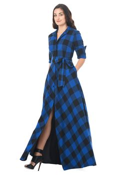 Our buffalo cotton plaid shirtdress is capped with a mandarin collar and the sash tied waist nips in the silhouette above a full skirt that gently swishes as you move.