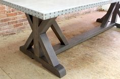 zinc dining table with X trestle table base. Hand crafted zinc dining tables and reclaimed wood furniture made to order by ecustomfinishes.com