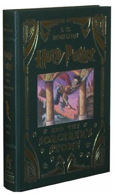 Love this leather bound copy of Harry Potter and the Sorcerer's Stone. Don't you? #harrypotter #leatherbooks