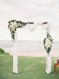white and greenery simple wedding arch ideas wedding beach 20 Stunning Beach Wedding Ceremony Ideas-Backdrops, Arches and Aisles - EmmaLovesWeddings Simple Wedding Arch, Wedding Arch Flowers, Wedding Ceremony Arch, Beach Wedding Reception, Beach Wedding Decorations, Simple Weddings, Beach Ceremony, Wedding Ceremonies, Wedding White
