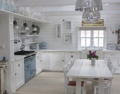 Summer cottage kitchen-blue and white table in middle of kitchen