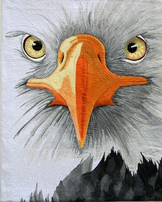 Eagle Eyes is a stunning fiber art work that shows a closeup view of an eagles face