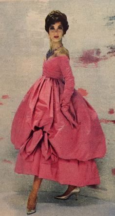 Christian Dior- 1958 Pink silk gown dress with an off shoulder long sleeved cross front blouse and large bubble skirt draped and caught in petals.  Elle No. 662- September 1, 1958