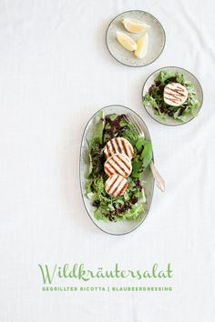 Wild herb salad with grilled ricotta and blueberry dressing
