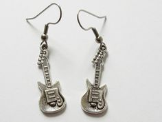 Check out this item in my Etsy shop https://www.etsy.com/listing/291129029/guitar-earrings-small-silver-tone