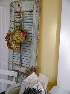 shutters....LOVE THIS!!!! and the soft yellow walls <3 May have to paint our new living room a soft yellow...yes I think so!!!