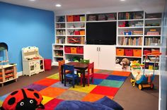 wall of shelving/buckets helps with the large toy and book issue while keeping a space for smaller toys.  Maybe the window in the TV spot and the dresser included in the built in where the doors are.
