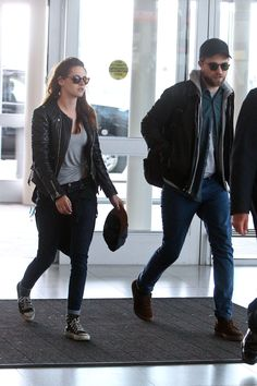 "4) Rob & Kristen at JFK May 8, 2013  {are you noticin' how ""in step"" they are???}"