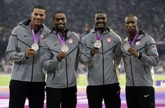 Trell Kimmons, Justin Gatlin, Tyson Gay and Ryan Bailey after receiving their silver medals for the men's 4x100m relay.