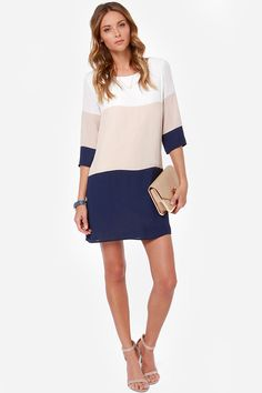 Lulus Exclusive! Nothing breaks through those cold-weather blues like a sun-kissed walk in the Citrus Grove Beige and Navy Blue Shift Dress! Contrasting bands of ivory, beige, and navy blue sharpen up a shift bodice and three-quarter sleeves. Bateau neckline. Back keyhole has top button closure.