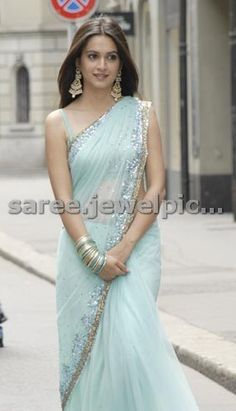 South Indian actress Kriti Kharbanda in beautiful blue designer embroidery shimmer saree with sequins buttes,mirror, silver and g. Saree Designs Party Wear, Saree Blouse Designs, Indian Attire, Indian Outfits, Indian Wear, Sarees For Girls, Sari Dress, Saree Trends, Stylish Sarees