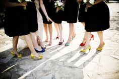 Different colored shoes and black gowns!  Now, if we can get some sashes to match the shoes, this would be the cutest!