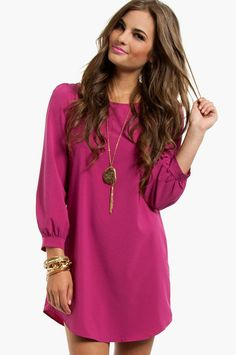 WINTER: This cute, simple rose color dress is beautiful for a winter skin tone. The rose color of this dress makes her hair and eyes pop. It is 3 quarter sleeve which gives the dress a little detail. This would be my ideal skin tone and dress!