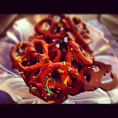 Chocolate covered pretzels. Pretty easy. Make a big bowl of melted chocolate - dark, milk, white, whatever! Dip in a pretzel, place on a wax paper covered baking sheet, sprinkle on some sprinkles and let cool in the fridge until the chocolate is hard. Fun and yummy!!