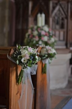 I like the idea of the veil-like material forming a bow on the end of the pews with a bouquet.