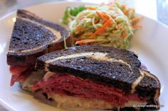 Grilled Rueben  Thinly Sliced Corned Beef on Grilled Marble Rye with Sauerkraut, Swiss, and Thousand Island Dressing with choice of Broccoli Slaw, Homemade Chips, or French Fries $12.49