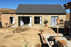 Ridge Rd Cottage - Clarens Accommodation. Pond Covers, Aluminium Sliding Doors, Bedroom With Bath, Queen Room, Outdoor Pool, Outdoor Decor, Pet Friendly Accommodation, Free State, Wrought Iron Gates