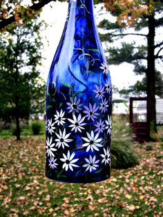 Recycled Wine Bottle Garden Light, Hanging Candle Holder, Blue Bottle Hand Painted - Recycled Wine Bottle Garden Light, Hanging Candle Holder Best Picture For rock crafts For Your Ta - Wine Bottle Garden, Wine Bottle Vases, Recycled Wine Bottles, Glass Bottle Crafts, Bottle Candles, Lighted Wine Bottles, Painted Glass Bottles, Christmas Wine Bottles, Bottle Painting