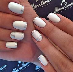 Short white nails with silver design
